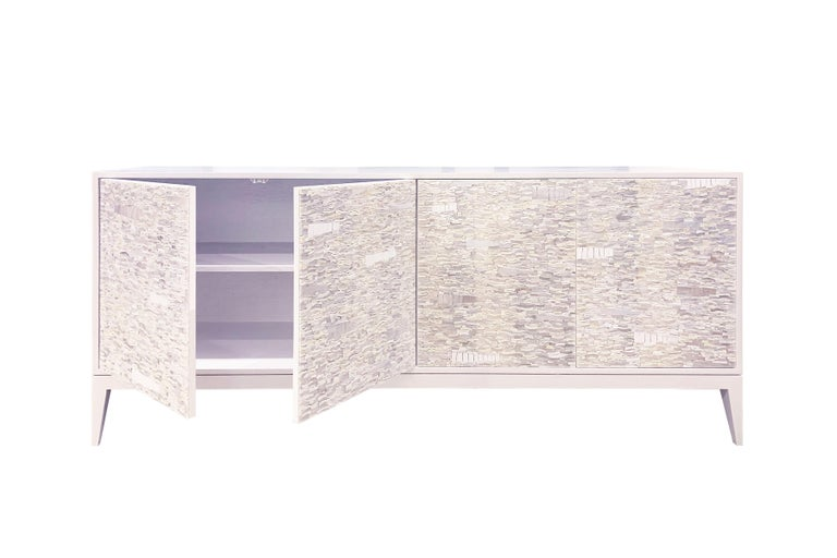 The Ravenna cabinet by Ercole Home has a 4-door front, with painted white wood finish on oak. 
