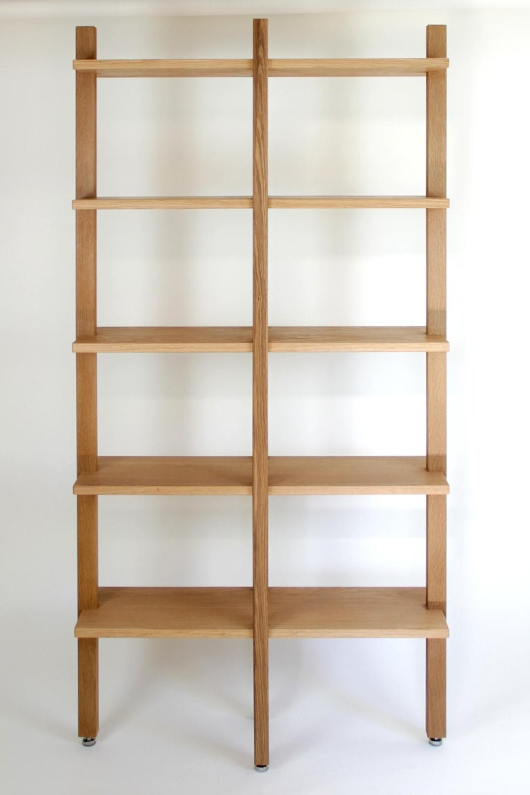 This bookshelf is handmade with traditional joinery and high level of craftsmanship. Thanks to its clean design and minimal elements it is easy to customize. It work well by it own or you can cover a wall with repited units. Shelfs depth can be