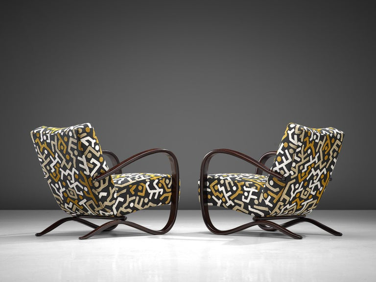 Jindrich Halabala, lounge chairs, reupholstered in Pierre Frey fabric and stained beech, Czech Republic, 1930s.   These extraordinary pair of Halabala chairs are recently upholstered with a graphical fabric by Pierre Frey, upholstery which is done