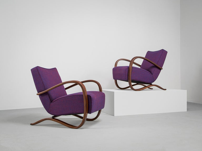 Jindrich Halabala, lounge chairs, purple kvadrat sunniva 0762 fabric and stained beech, Czech Republic, 1930s.   These extraordinary pair of Halabala chairs are recently upholstered with a purple Kvadrat sunniva upholstery which is done in our own