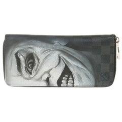 "Customized ""Joker"" Louis Vuitton Zippy wallet in damier graphite canvas"