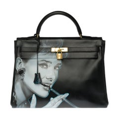 "Customized Kelly 35 ""Audrey Hepburn"" handbag in black calfskin and gold hardware"