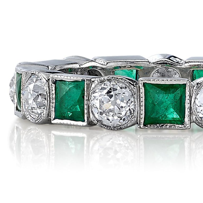 Approximately 1.40ctw old European cut diamonds alongside 1.55ctw Square cut emeralds set in a handcrafted platinum eternity band.  All of our jewelry is individually made to order in Los Angeles, please allow 6-8 weeks for delivery.   Please list