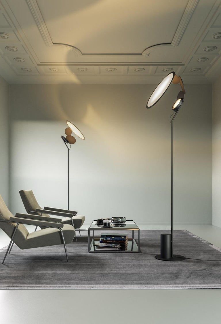 """Winner of a """"Gooddesign"""" award 2019/2020 for the Lighting category, Cut is the result of a long design process between Axolight and Timo Ripatti, aimed at the design of an adjustable lamp, that can be positioned on three points and never glares."""