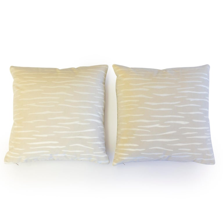 A pair of throw pillows hand sewn in cut velvet with strike design.  Made to order.  All pillows are hand sewn at our studio in Norwalk, Connecticut.   Measurements: 20