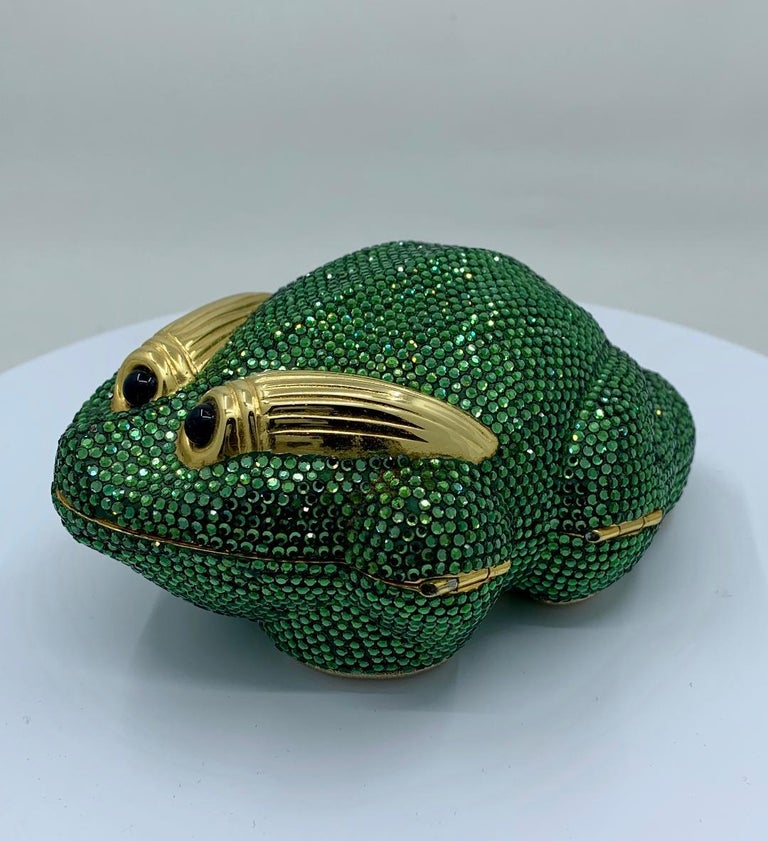 Fabulous handmade couture designer, Judith Leiber, crystal Frog minaudiere evening bag or evening clutch is completely covered in green crystals. Gold toned metal frame with metallic gold leather lined interior with compartments and a long gold