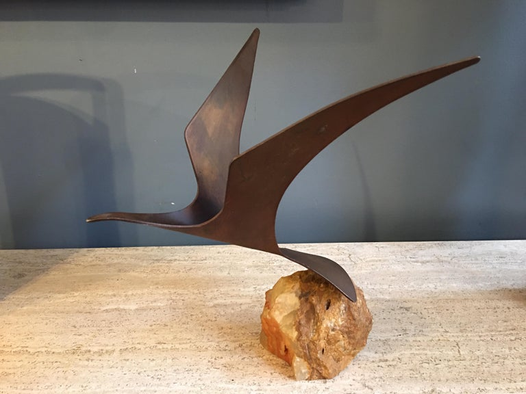 Curtis Jere signed metal seagull on a rough cut stone vase. Can be turned on rock in many positions.