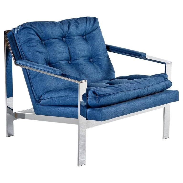 Restored, vintage chrome lounge chair by Cy Mann in the style of Milo Baughman. The lounge chair has been updated with luxurious royal blue fabric by our in-house upholsters. We used the original pattern to recreate the tufted seat and back layout.