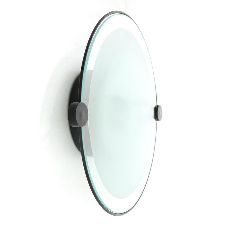 Applique or ceiling lamp produced by Artemide in the 1980s, designed by Michele De Lucchi. Rough effect black painted metal structure. Circular diffuser in sandblasted glass and transparent glass frame. Good general conditions, some signs due to