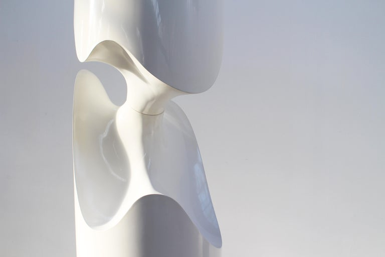 The white cylindrical TOTEM sculpture, produced in 1998 in France. 