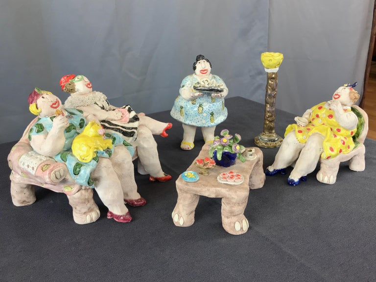 A 1987 five-piece ceramic sculpture of ladies at tea by Sonoma, California, artist Cynthia Hipkiss (b. 1948).  Whimsical vignette full of witty details depicting a lively sitting room tea party attended by a colorful quartet of carefree women.