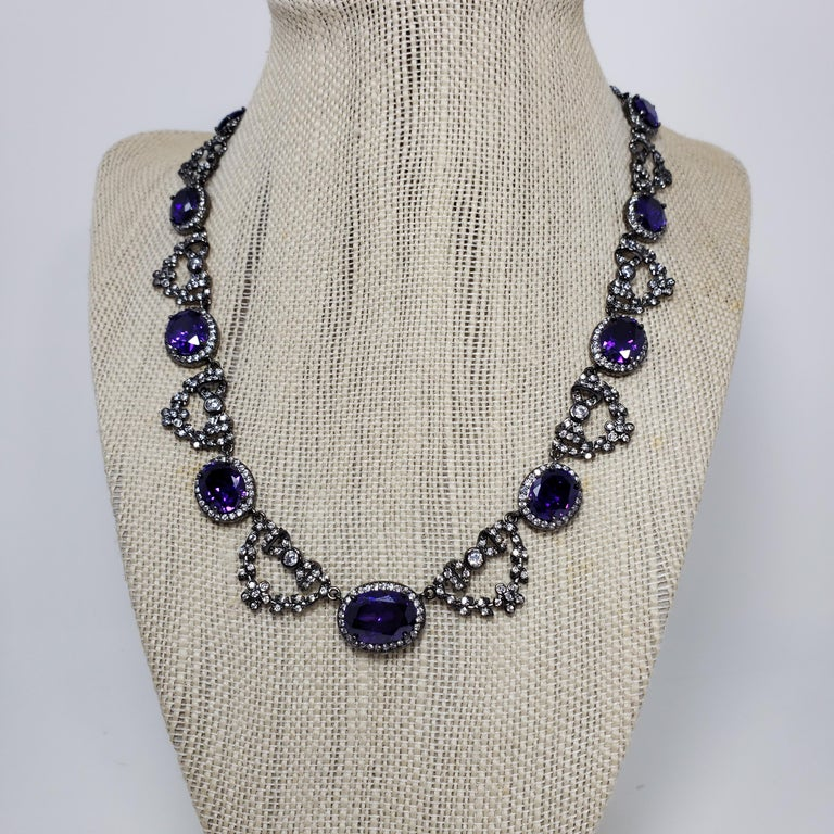 Cubic Zirconia by Kenneth Jay Lane 35Cttw multi CZ Russian garland collar necklace. Features amethyst cubic zirconia crystals accented with clear crystals and decorative bow motifs for a luxurious touch. A sophisticated touch to any