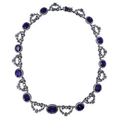 CZ by Kenneth Jay Lane Amethyst Crystal Necklace with Bow Motifs