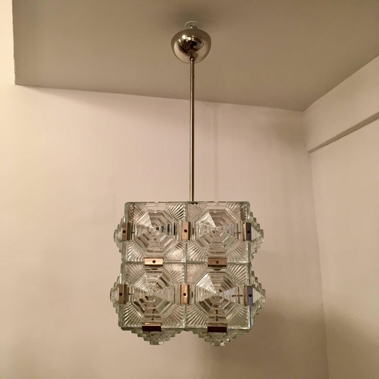 A wonderful chrome and thick geometric cut crystal by Czech maker, Kamenicky Senov. Newly rewired. 1 ea. medium base bulb. 100 watts max.