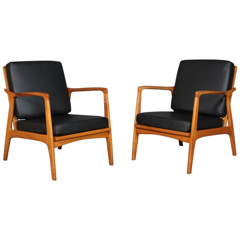 Czech Design, Two Lounge Chairs, Oak and New Upholstered with Black Leather For Sale