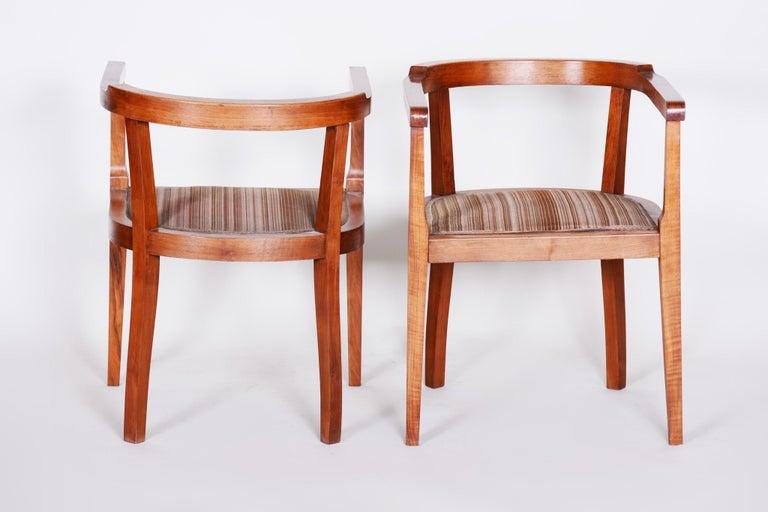 Pair of Art Deco armchairs. Material: Walnut Source: Czechia Period: 1920-1929.