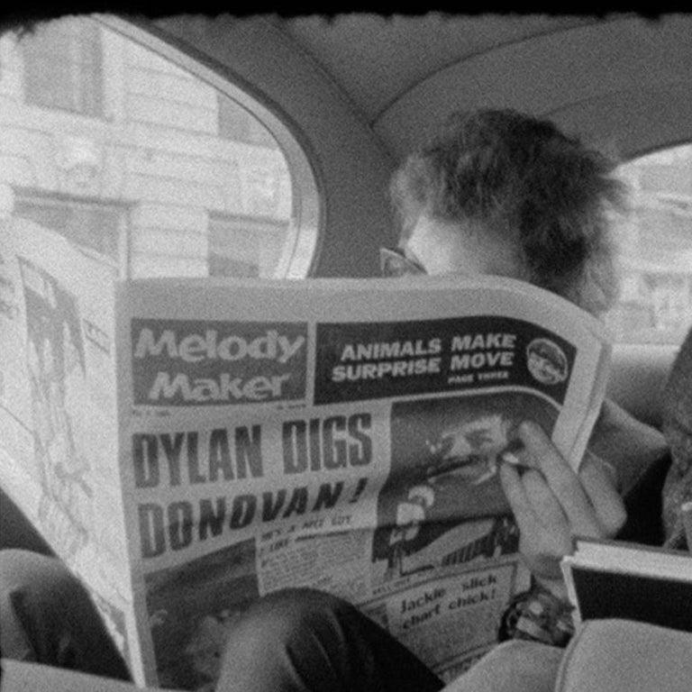 Bob Dylan reading Melody Maker with John Mayall looking on London 1965  2