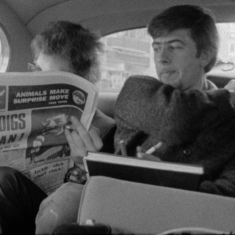 Bob Dylan reading Melody Maker with John Mayall looking on London 1965  3