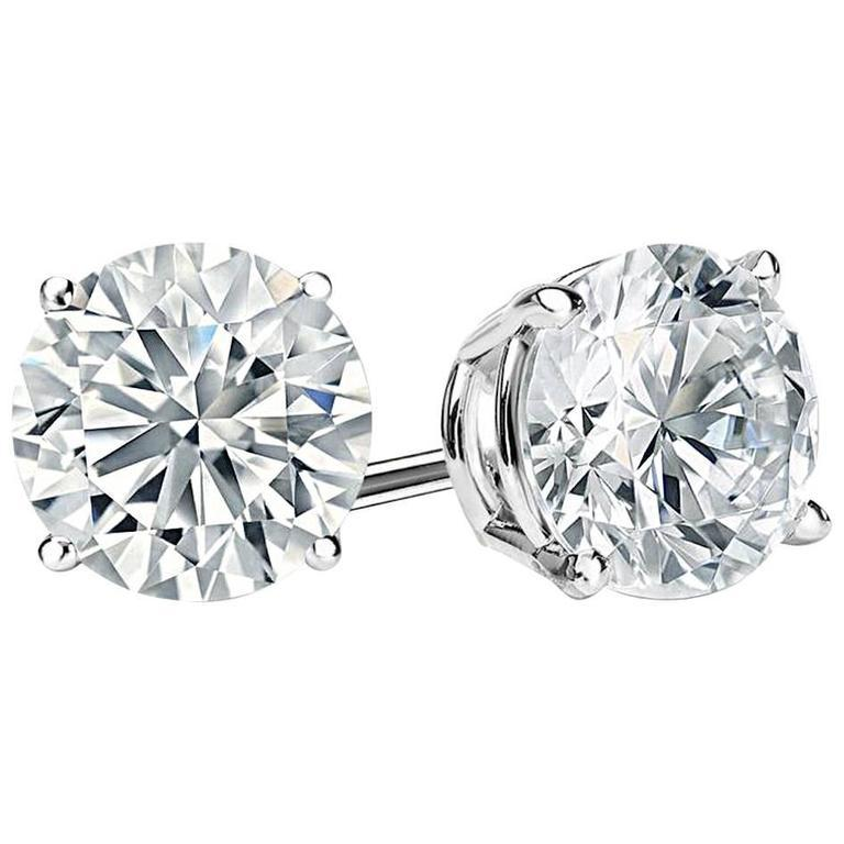 Amazing special diamond cut faux diamonds 6 carats each studs set in rhodium sterling silver. These are the finest ever made modern cut round faux diamonds of cubic zirconia. Half an inch diameter.  Total real diamond carat weight look would be 12