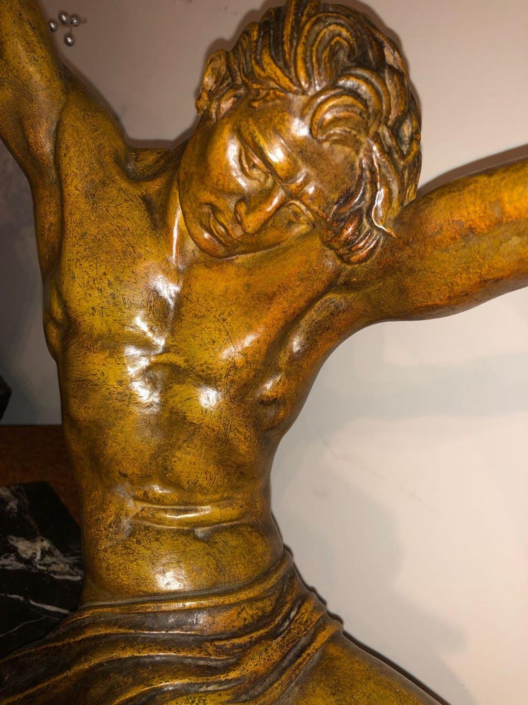 """""""L'Age du Bronze"""" sculpture by Demetre Chiparus, a powerful French spelter statue is sometimes referred to as the famous """" bending bar man"""" It was made in two sizes and this one, much more rare, is the larger size of 34 """" X 6.5? D X 21? T, the"""