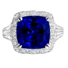 6.99 Carat Cushion Cut Tanzanite and Diamond Halo Ring in 18k White Gold
