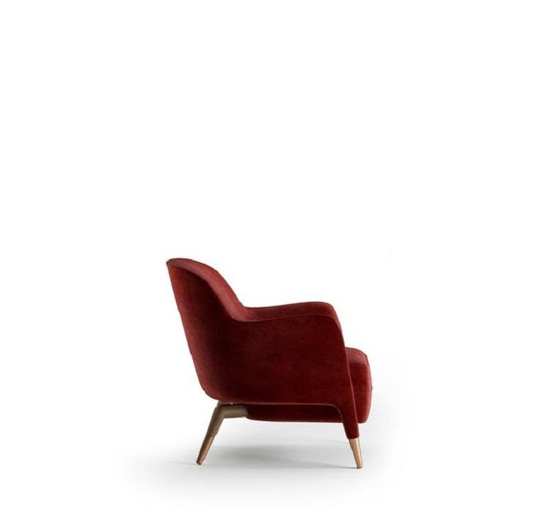 Armchair with medium height backrest and wood structure   100% Made in Italy Residential and Commercial spaces design versatility Completely removable covers.