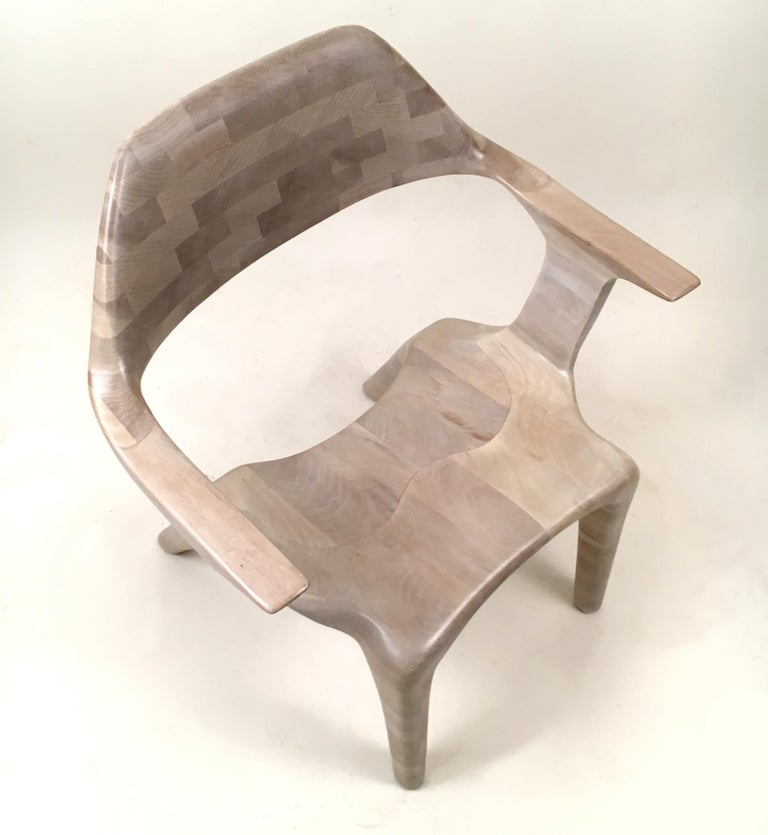 The D2 chair lounge chair is made from solid (bleached) cherry using the stacked lamination technique. Despite its thin lines and dramatic curves, the chair is designed to support significant weigh, and the ergonomic design lends itself to relaxed