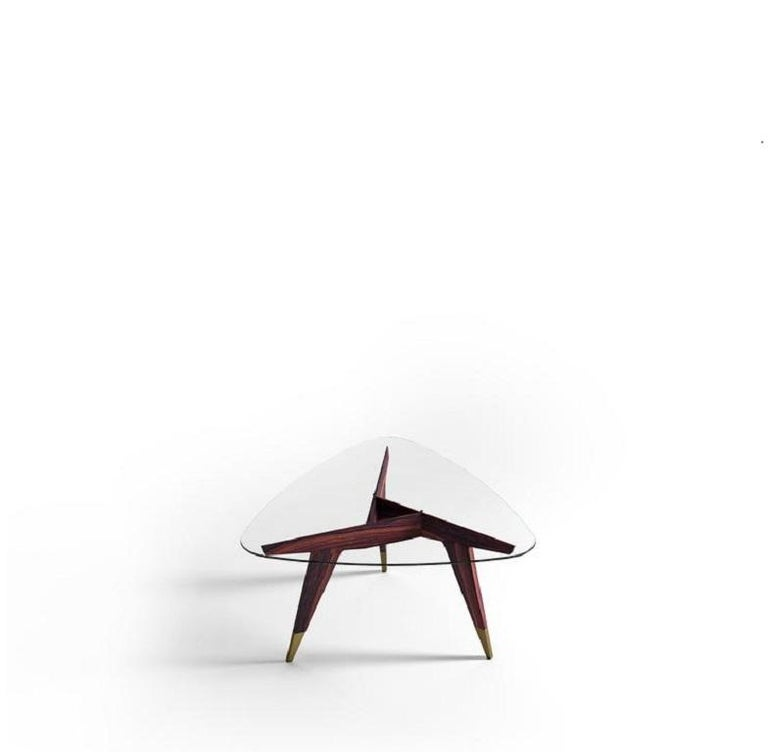 Architecture, a pan virtuosity, acrobatic proportions and an intersection of joints.  100% Made in Italy Based on the original drawings from the Ponti Archives Geometric dialogue between the glass and rosewood.