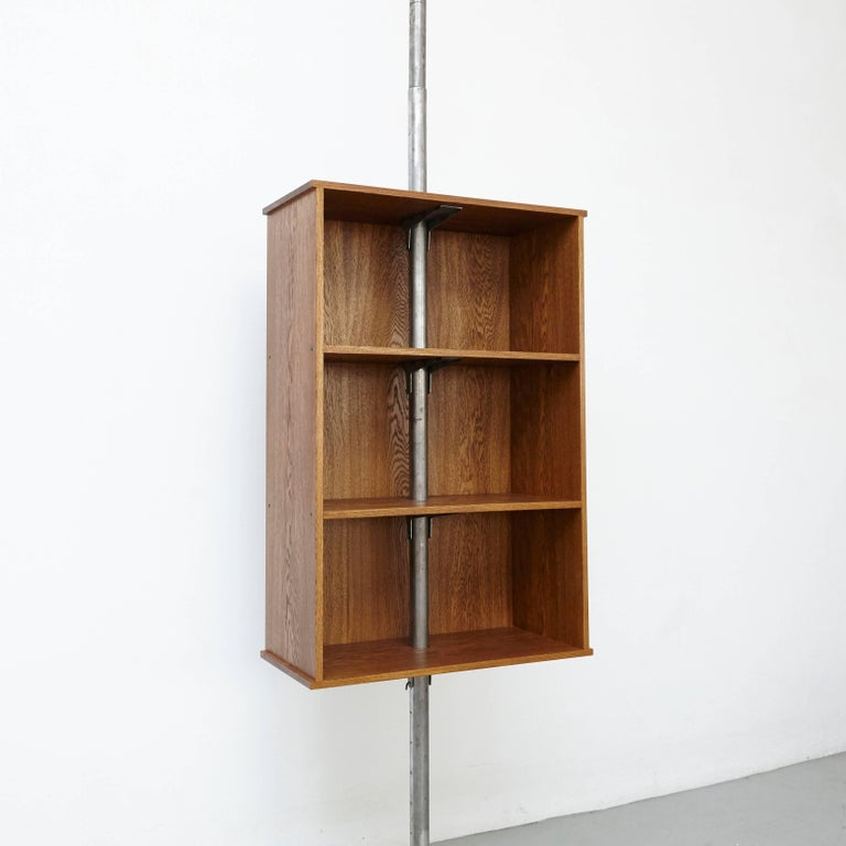 Bibliotheque designed by dada - est. manufactured in Barcelona, 2017.  Adjustable bibliotheque suspended,  Iron and oak  Measures: 40 x 91 x 420 cm.