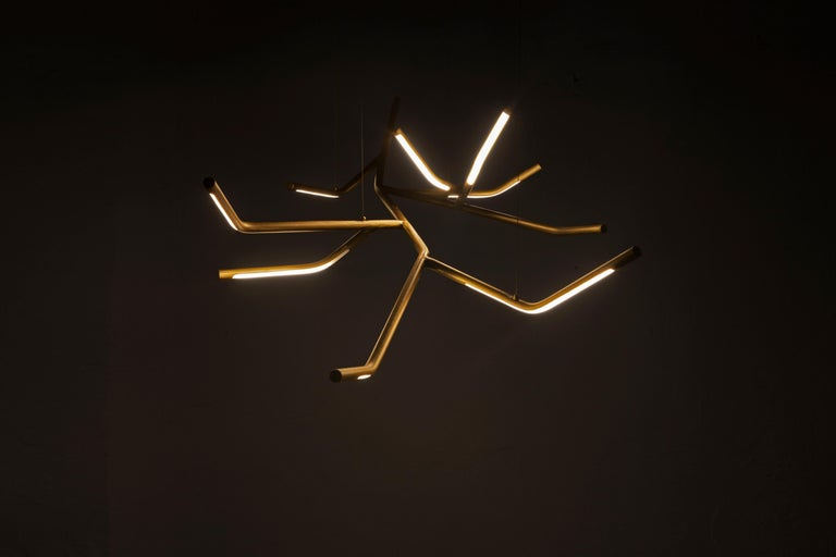 Dafne pendant light sculpted by Morghen Materials: Grinded brass, LED Light, silicone Dimensions: 130 x 70 x 60 cm  Made to order dimensions are possible. We can customize all its details and give a complete service of 3D modelling, in order to