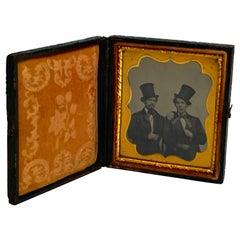 Daguerreotype Portrait of Two Men Embracing, Smoking with Ties and Top Hats