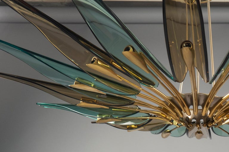 """Chandelier composed of sixteen translucent green and amber glass """"petals"""" mounted to a radial brass structure, suspended from three rods and matching canopy. Fontana Arte model number 1563. Literature: Franco Deboni's Fontana Arte: Gio Ponti, Pietro"""