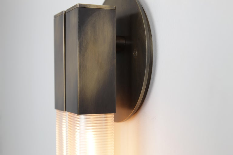 POST  2.0 Sconce  The Post 2.0 Sconce celebrates the poetic dialogue between light and form to create a fixture that leans into the timeless and iconic. Can be mounted horizontally. Custom sizes available.  Material options: steel, brass  Finish