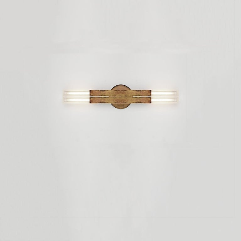 POST  KoKo sconce   The KoKo sconce celebrates the poetic dialogue between light and form to create a fixture that leans into the timeless and iconic. Can be mounted horizontally or vertically. Length customizable.  Material options: steel,