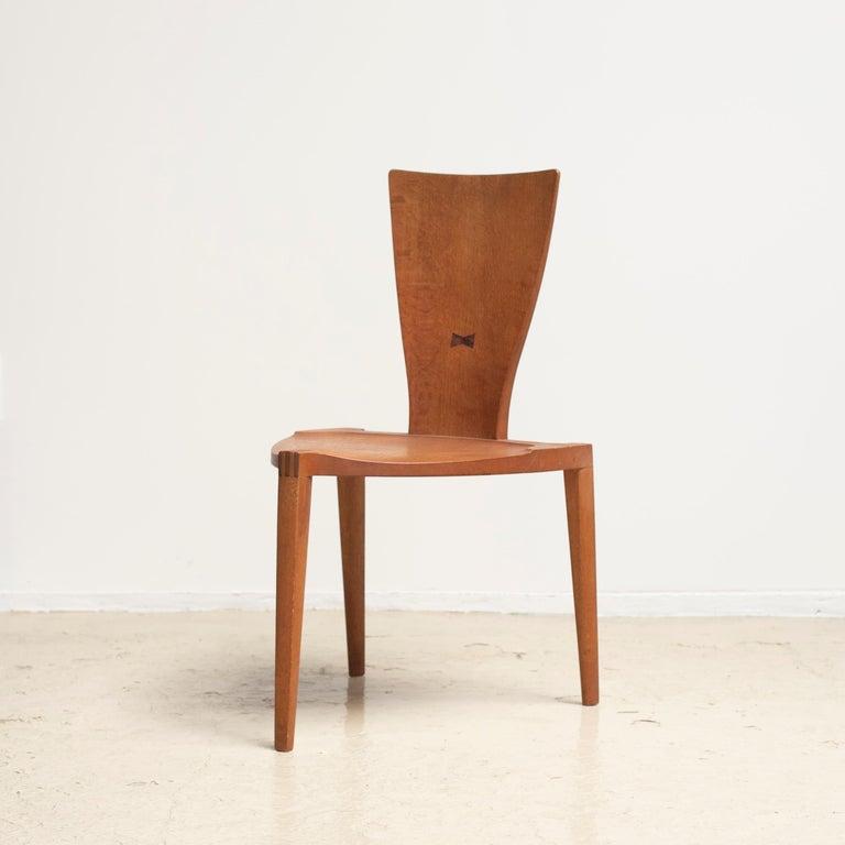Three legged chair named