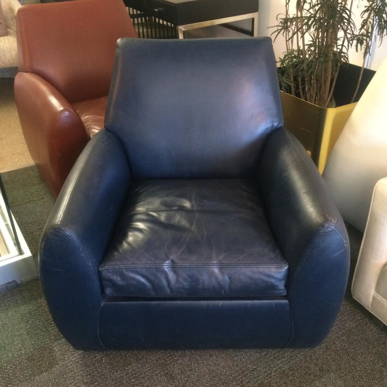 Beautiful leather armchair designed by Dakota Jackson. The chair is fully upholstered in leather, the leather is in good original condition with some nicks and mild scratches. The seat shows signs of wear and the foam might need to be replaced.