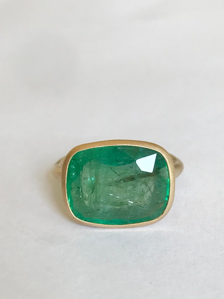 Dalben design One of a Kind 18k yellow gold matte finishing ring with a 8,08 carat bezel-set cushion cut emerald.  Ring size 7 1/4 USA - EU 55 re-sizable to some finger sizes.  The emerald have natural visible inclusions . Bezel stone dimensions