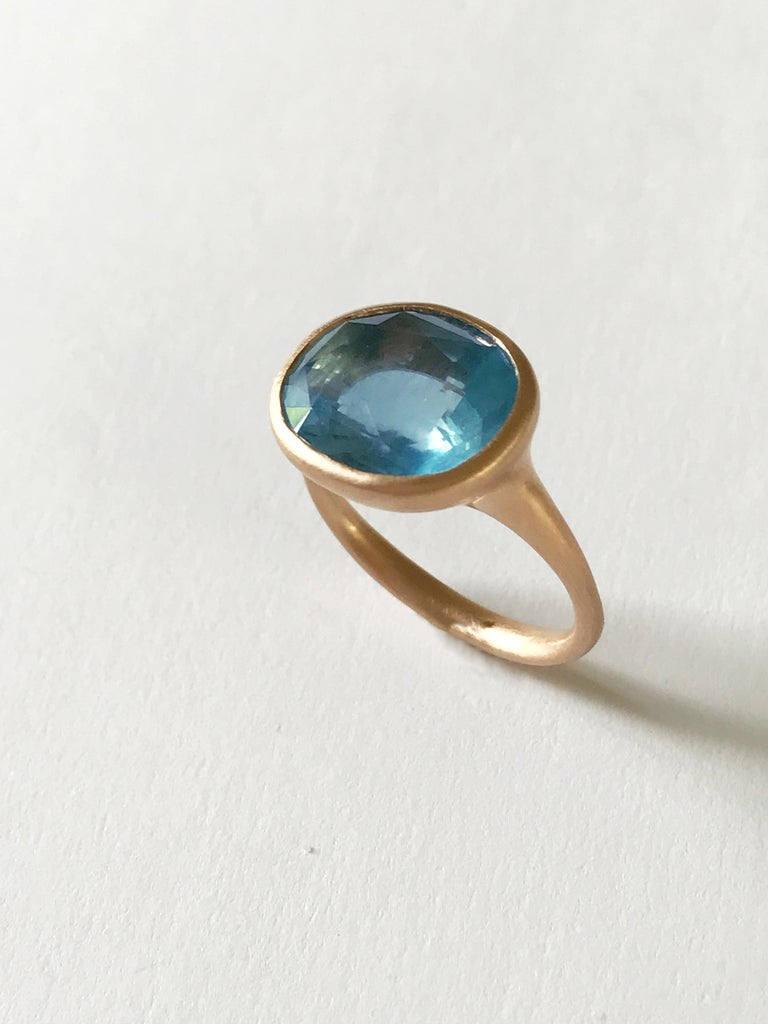 Dalben design  18k rose gold matte finishing ring with a 6,13 carat bezel-set oval faceted cut deep blue Aquamarine .  Ring size 7 1/4 USA - EU 55 re-sizable to most finger sizes.  Bezel stone dimensions : height 12,8 mm width 15 mm The ring has