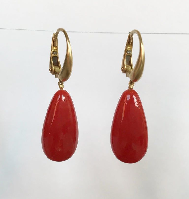 Dalben design 18 kt semi-lucid finished yellow gold earrings with two long drop shape Mediterranean Red Coral 10,8 x 21,4 mm  weight 23 carat .  Earrings dimension :   width 10,8 mm  height with leverback 37,6 mm   The earrings has been designed and