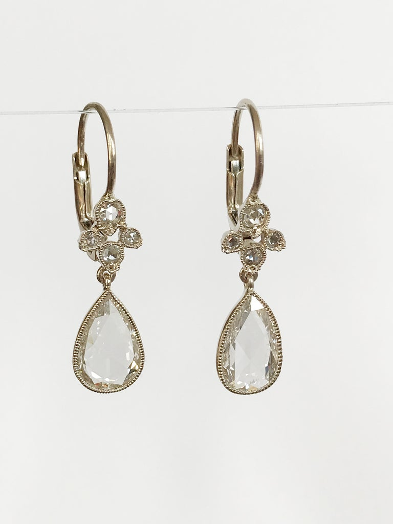Dalben design One of a Kind 18k white gold earrings with two  bezel-set pear shape rose cut diamonds weigh  1,18 carat and a floral motif  with rose cut diamonds weigh 0,16 carat. The stone setting is finished with