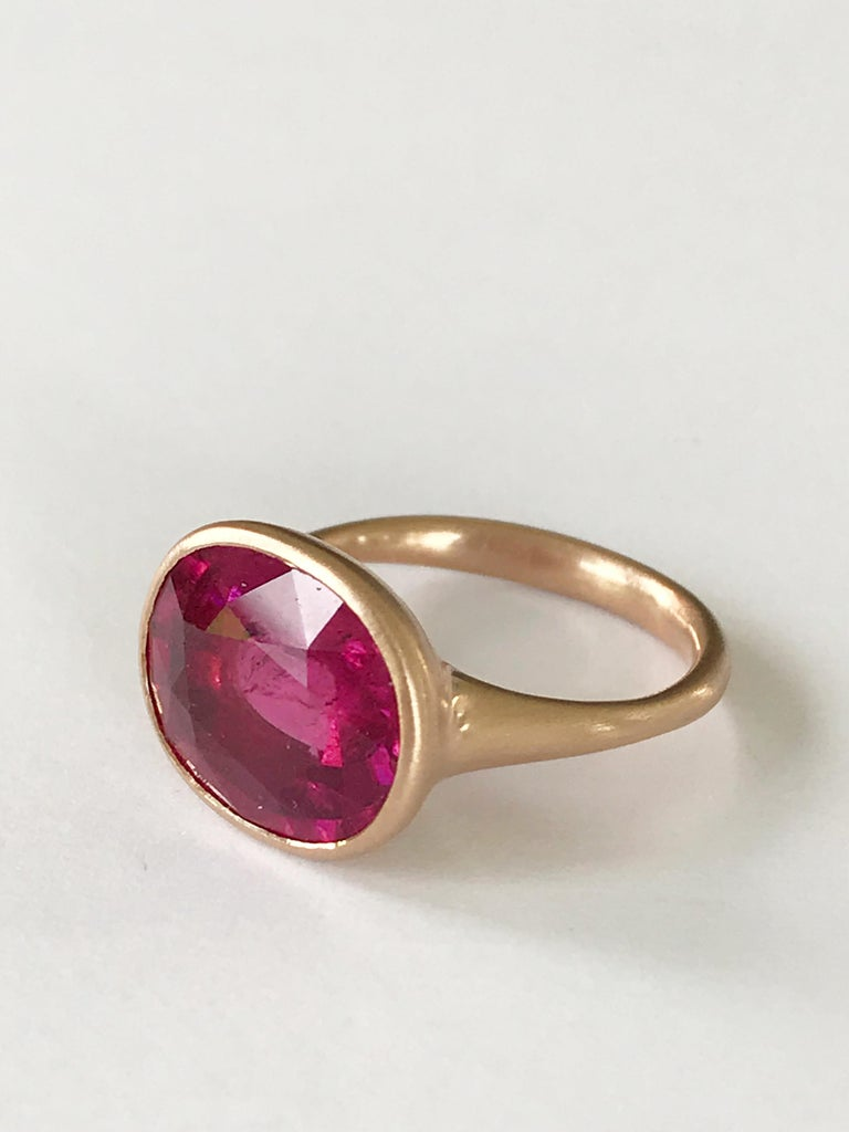 Dalben design  18k rose gold matte finishing ring with a 6,20 carat bezel-set oval faceted cut Rubellite ( Red Tourmaline ).  Ring size 7 1/4 USA - EU 55 re-sizable to most finger sizes.  Bezel stone dimensions : height 12,4 mm width 14,9 mm The