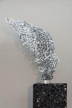 Murmuration - tall, metal, abstracted human face, aluminum sculpture