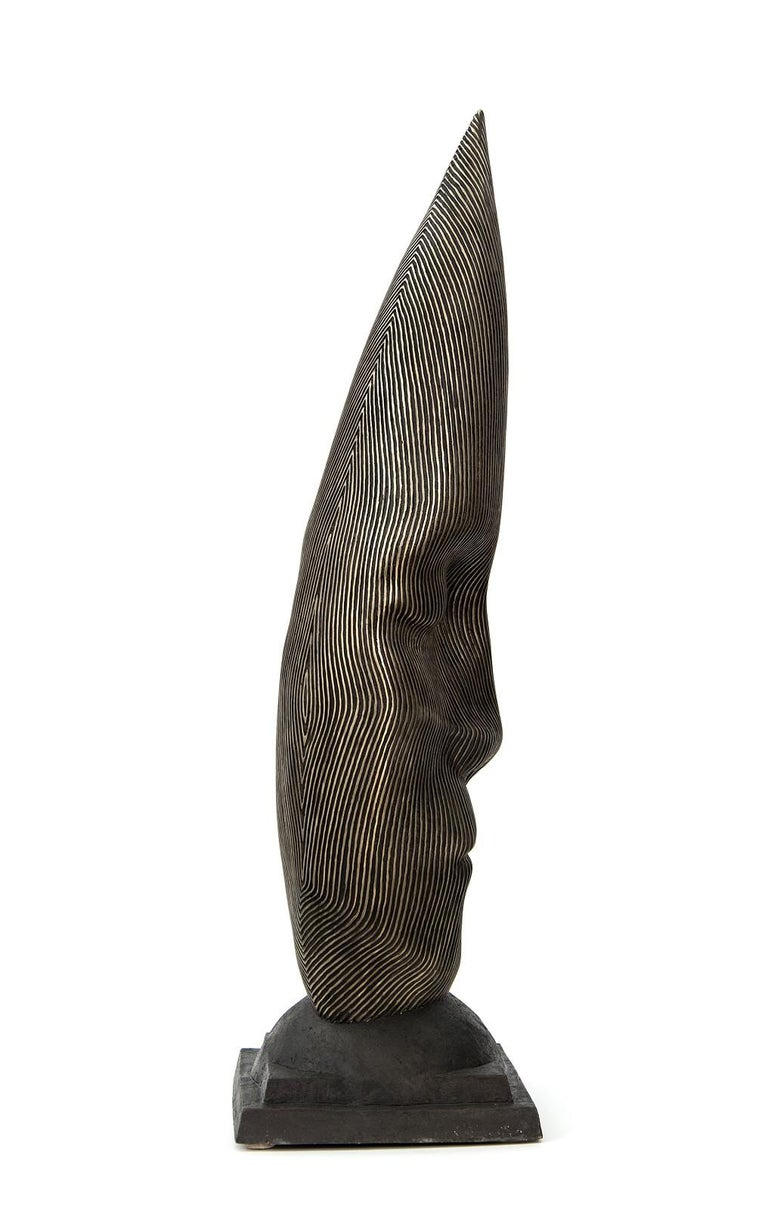 Sentinel - tall, dark, abstract, human face, head, bronze, sculpture - Gold Figurative Sculpture by Dale Dunning