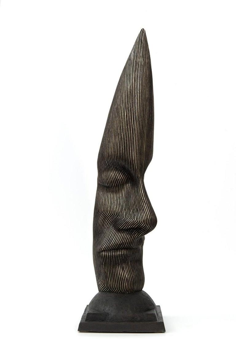 Dale Dunning Figurative Sculpture - Sentinel - tall, dark, abstract, human face, head, bronze, sculpture