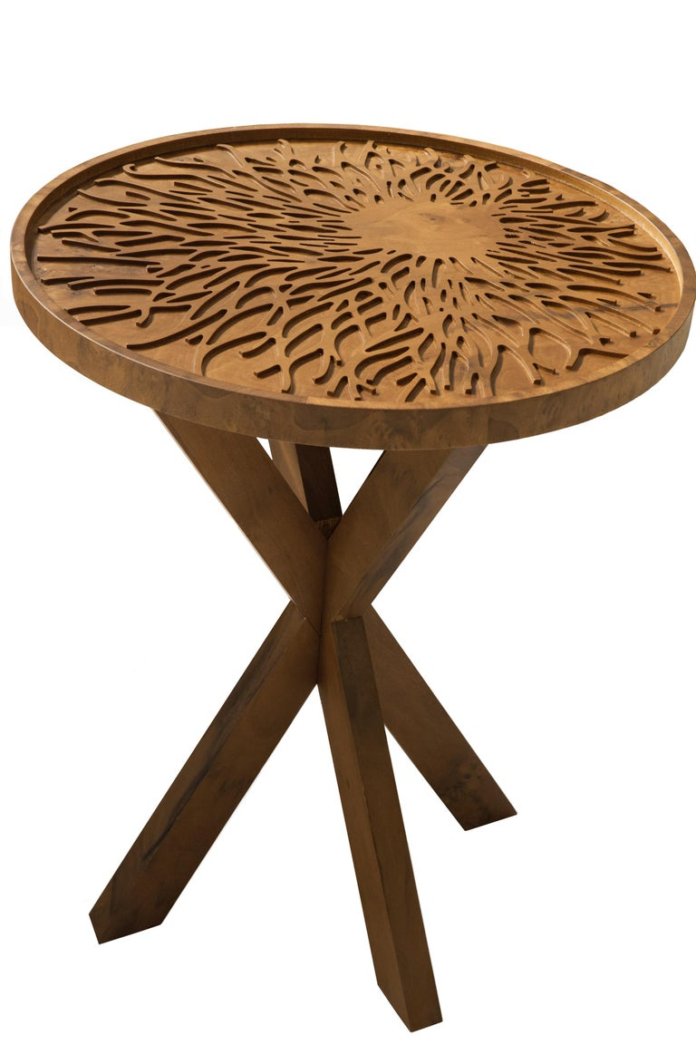 Solid wood intricately engraved with Sisli's signature branches makes this side table an artful addition to any seating area.