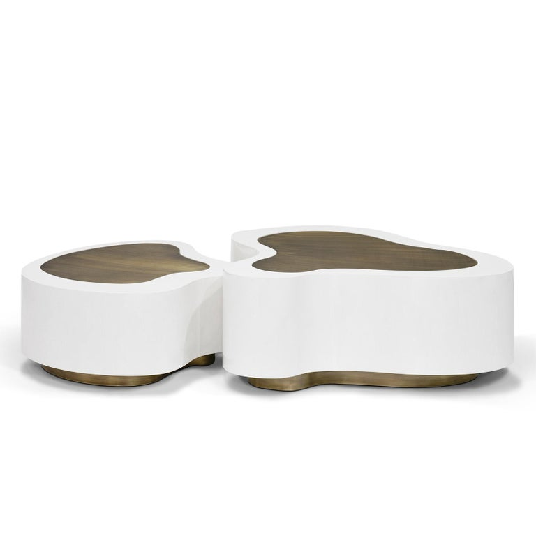 Coffee table Dalia white brass set of 2 with solid sycamore wood structure covered with white matte finish. With curved solid brass  tops in vintage finish. With solid brass base in vintage finish. Also available in white gloss finish. Also