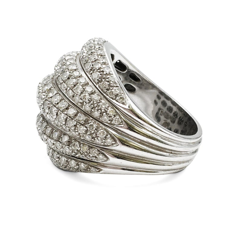 Authentic Damiani dome-shaped cocktail ring crafted in 18 karat white gold featuring 5 rows of high-quality round brilliant cut diamonds weighing an estimated 3.75 carats of round brilliant cut diamonds. Signed Damiani, 750, with serial number. Ring