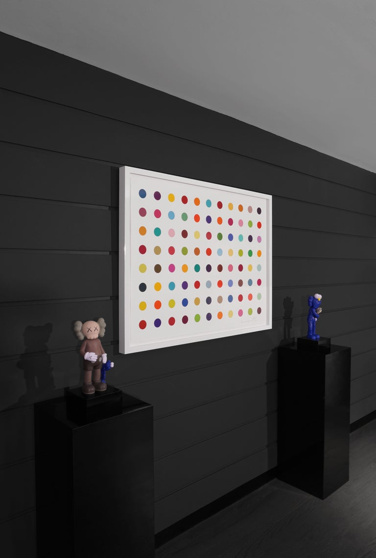 The Horizontal Multi-color 'Spots' by Damien Hirst is a woodcut in his signature, bright color palette formed with series unique colors. This exquisite piece is created in a limited edition of only 55 in existence. Signed by the artist in pencil in