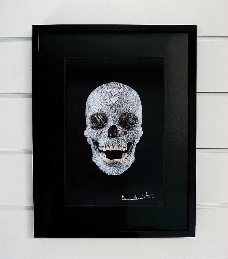 "A brilliant lenticular print of a three dimensional Skull created by Damien Hirst, entitled: ""For The Love Of God"". The artwork comes ready to install in a custom black lacquer frame with complementing black textured matte. The shimmering effects of"