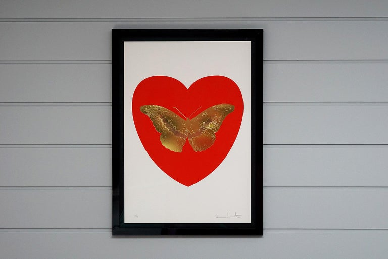 This Artwork is a part of the limited edition series 'I Love You' by Damien Hirst. Created in Hirst's signature style using butterflies as a symbolism for the celebration of life. This particular work features a foil-block butterfly surrounded by a